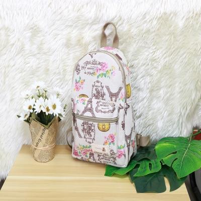 กระเป๋าสะพายหลังลายดอกไม้และผีเสื้อ สีครีม