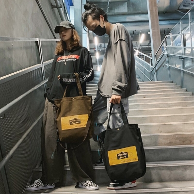 กระเป๋าสะพายข้างสกรีนอักษร Bagofficialshop มี 4 สี